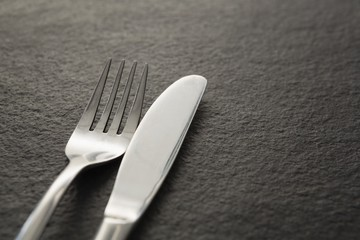 Fork and knife on black background