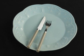 Plate and cutlery set on a table