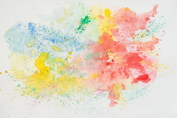 Abstract watercolor background, iridescent texture in colorful shades of vivid bright colors on white paper, rainbow