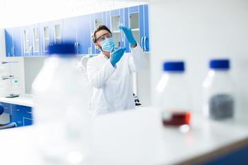 Smart handsome scientist standing in the lab