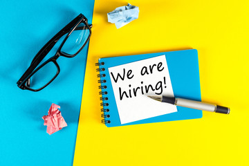 WE ARE HIRING CONCEPT ON bright background at new job place