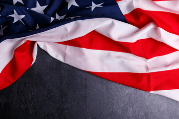 The American flag lies at the top on a gray background