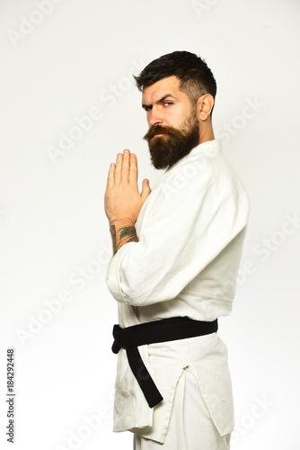 Taekwondo master with black belt holds hands together in greeting taekwondo master with black belt holds hands together in greeting m4hsunfo