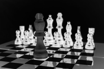 Chess. Chessboard. One against one. Chessmen. Black and white. Concept of confrontation.