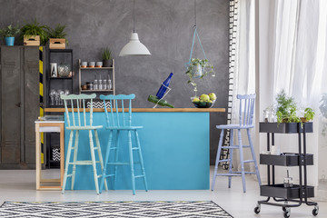 Stools and blue kitchen island
