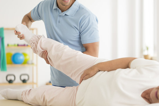 Personal physiotherapist rehabilitating joints