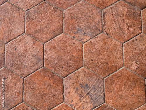 Old terracotta floor tiles, hexagonal