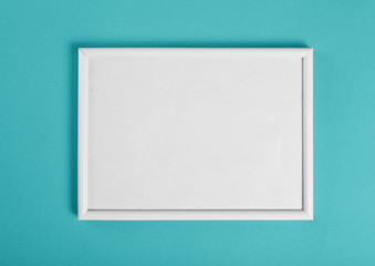 White wooden frame for painting or picture on green background