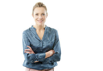 Confident mature woman standing against white isolated background