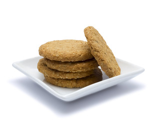 Nut cookies on a saucer.