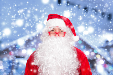Asian santa claus on blurry christmas with snow background,Happy merry christmas