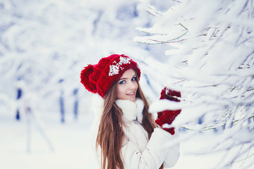 Young woman winter portrait in hat outdoor