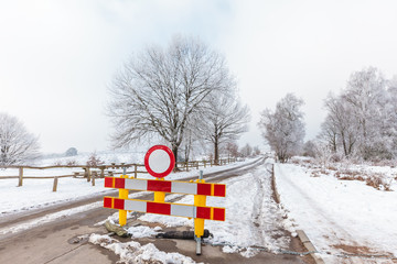 Winter scene with cloesd road on the Dutch Posbank