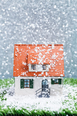 Picture of toy house with falling snow