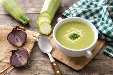 zucchini soup in bowl on wooden table