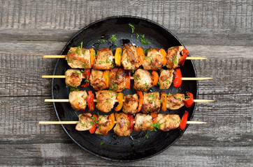 Grilled chicken kebabs with vegetables