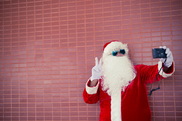 Santa claus with camera for selfie,Thailand people,Sent happiness for children,Merry christmas,Welcome to winter