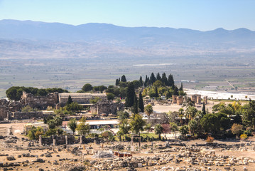 The ruins of the ancient Hierapolis city next to the travertine pools of Pamukkale, Turkey