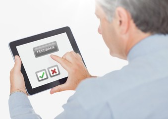 Hand holding tablet with feedback satisfaction buttons