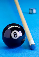 Billiard pool game eight ball with chalk and cue on billiard table