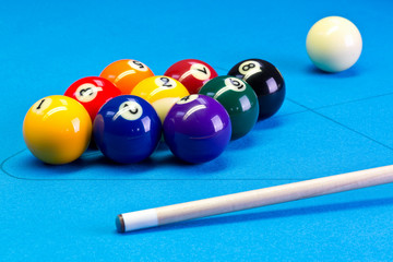 Billiard pool game nine ball setup with cue on billiard table