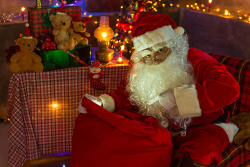 Santa Claus open red sack for looking,Merry christmas,Happiness to the children,Welcome to winter,Happy new year,light from bag
