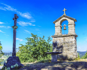 "bell tower and stone cross on the top of the hill called ""La Espenuca"""