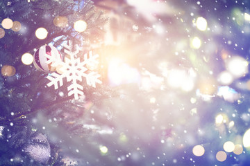 Christmas abstract background with snowflakes and lighting effect