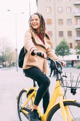 young woman outdoor biking