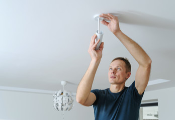Installing a lamp at home.