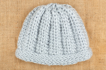 Woolen cap isolated on linen background.