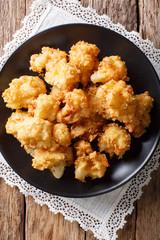 Vegetarian meal: fried cauliflower in breadcrumbs closeup. Vertical top view
