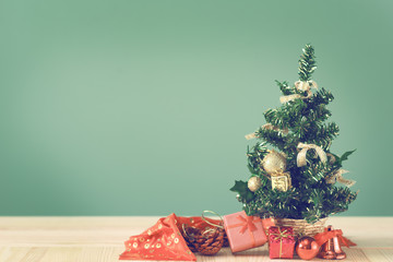Festive Christmas tree stands on light boards. Christmas background. Christmas decorations on a green background. Space for text. New Year's background. Toned image.