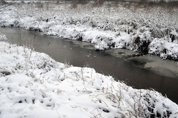 Abandoned drainage canal.Near Kiev at winter