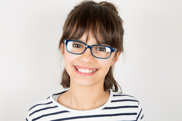 Portrait of a happy little girl with glasses