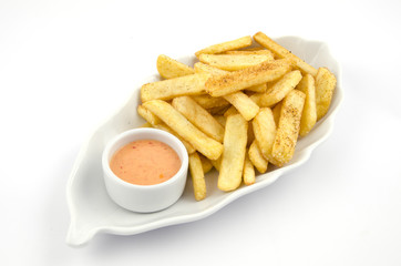 potato fries and sauce on the plate on the white background