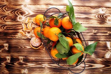 fresh mandarin oranges fruit with leaves in basket