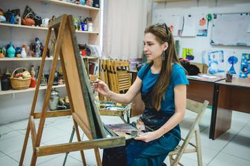 Redhead girl in art studio