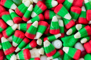 background wallpaper full frame close up of red, green and  white Christmas candy corn