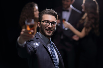 elegant man raising his glass with the toast