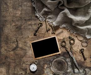 Vintage photo frame antique items scissors keys flat lay