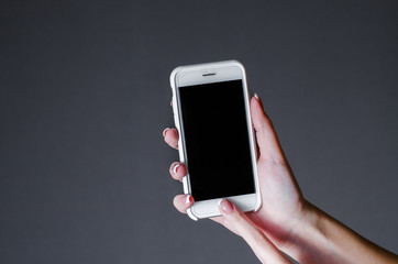 white smartphone in a woman's hand