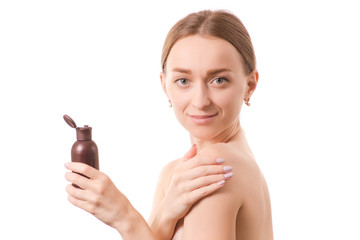 Beautiful young woman beauty bottle face with cosmetics for body and face oil lotion
