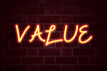 Value  neon sign on brick wall background. Fluorescent Neon tube Sign on brickwork Business concept for Importance Use Benefit Principles Morals Ethics 3D rendered
