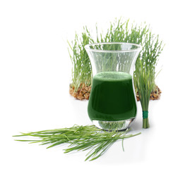 Shot of healthy juice and sprouted wheat grass on white background