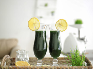 Glasses of wheat grass juice on tray