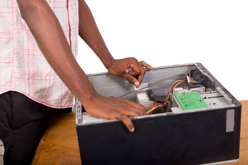 close up of technician hands repairing a computer isolated on wh