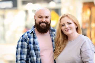Overweight couple on city street