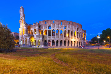 Colosseum or Coliseum during blue hour, also known as the Flavian Amphitheatre, the largest amphitheatre ever built, in the centre of the old city of Rome, Italy.
