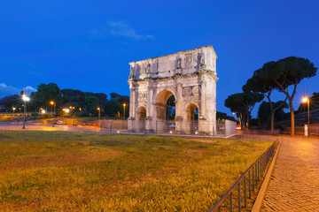 The Arch of Titus during blue hour, in the centre of the old city of Rome, Italy.